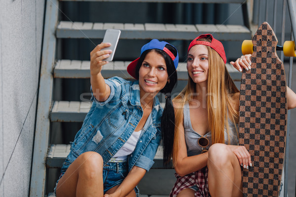 brunette and blode girls make selfie Stock photo © chesterf