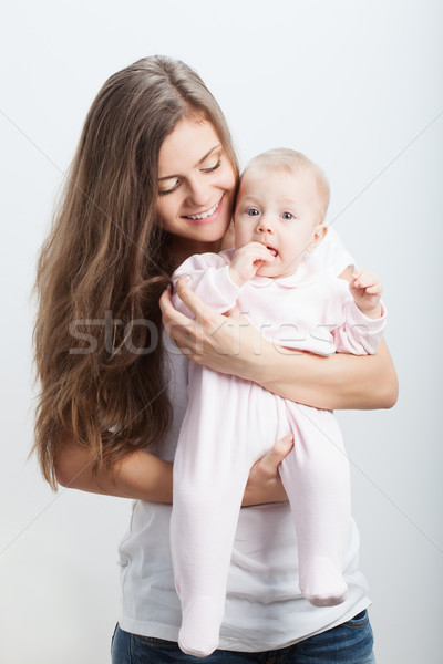 young mother  holding her baby girl on hands Stock photo © chesterf