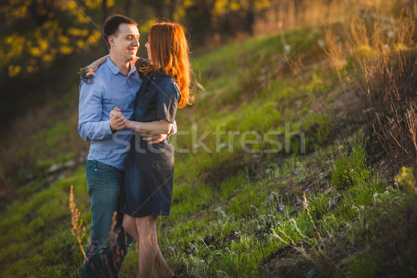 couple kissing standing outdoos among bushes Stock photo © chesterf