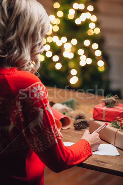 blonde woman writing on christmas postcard Stock photo © chesterf