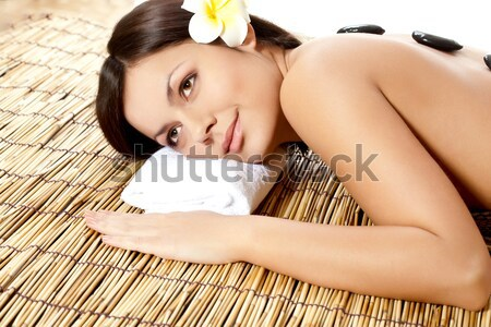 sleeping woman laying on bamboo mat Stock photo © chesterf
