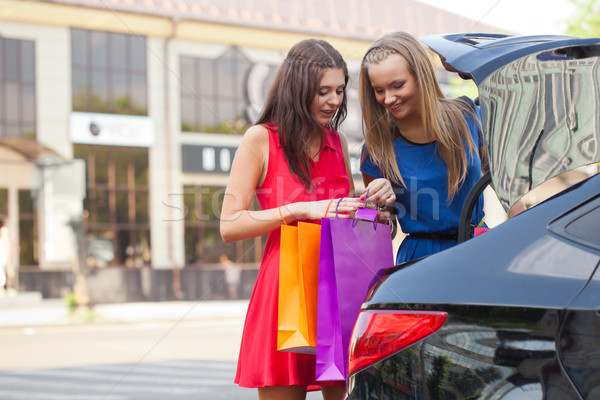 two girls are piling the bags in the car Stock photo © chesterf