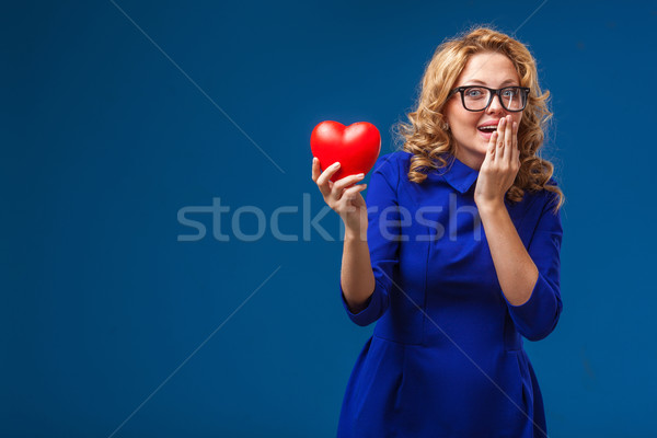 funny woman holding heart shape Stock photo © chesterf