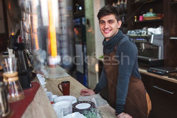 barista man portrait behind the bar in cafe Stock photo © chesterf