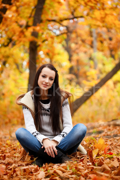 woman sitting on fallen leaves Stock photo © chesterf
