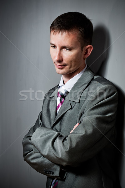 thinking businessman portrait near wall Stock photo © chesterf