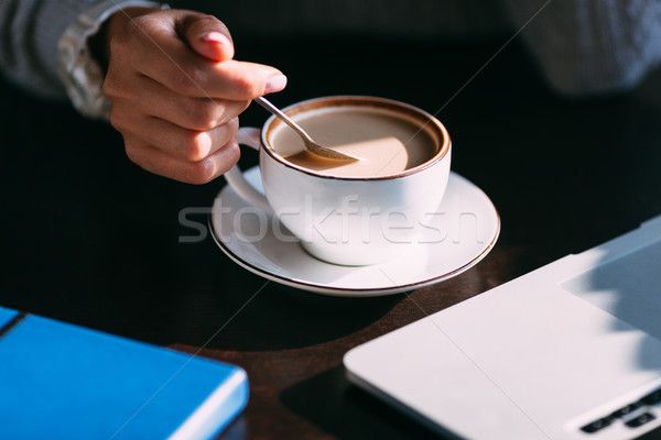 Woman holds hot cup of coffee, warming her hands Stock photo © chesterf