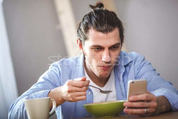 若い男 食べ ミルク と 見える ストックフォト © chesterf