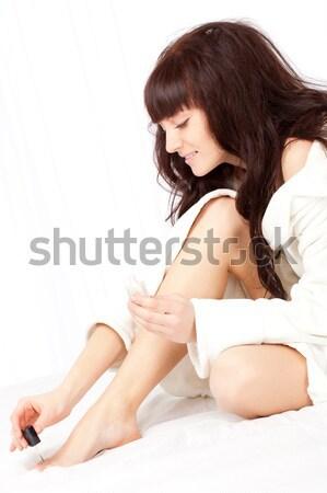 Stock fotó: Nő · visel · fürdőköpeny · gyönyörű · nő · ül · ágy