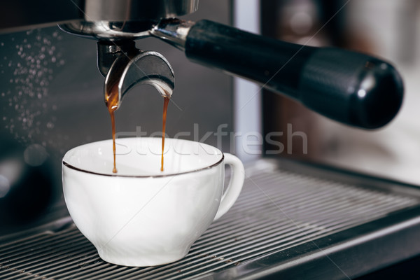 close-up of espresso pouring from coffee machine Stock photo © chesterf