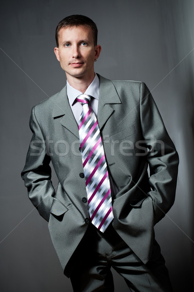 buisnessman portrait over gray Stock photo © chesterf
