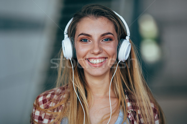 beautiful girl portrait wearing headphones. Stock photo © chesterf
