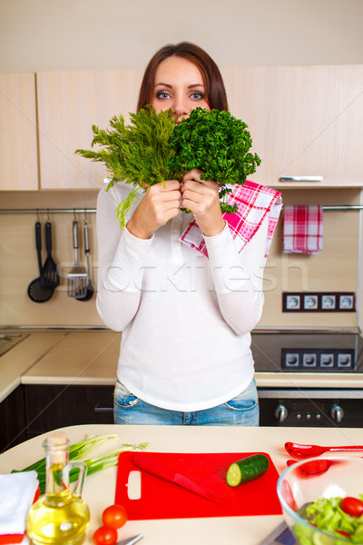 Smiling young housewife mixing fresh salad Stock photo © chesterf