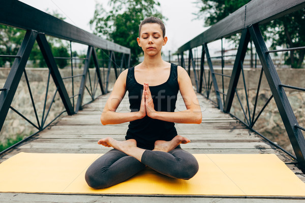 young slim woman doing yoga Stock photo © chesterf