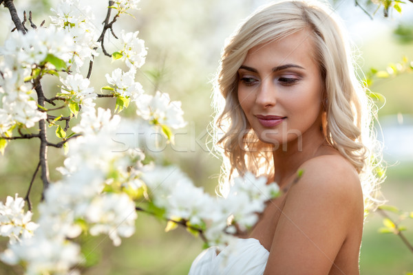 blonde woman in a flowered garden Stock photo © chesterf