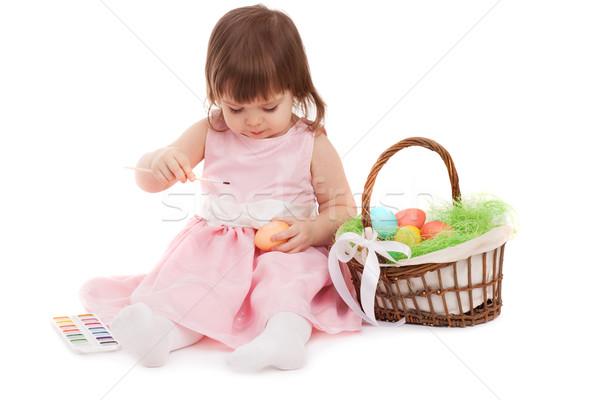 Kislány festmény húsvéti tojások fehér festék tojás Stock fotó © chesterf