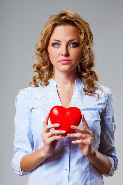 seriuosly woman holding red heart symbol Stock photo © chesterf