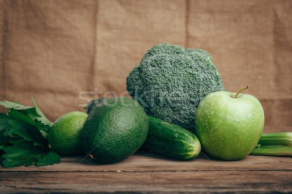 avocado, apple, lime, celery, cucumber, broccoli, wooden rustic table background Stock photo © chesterf