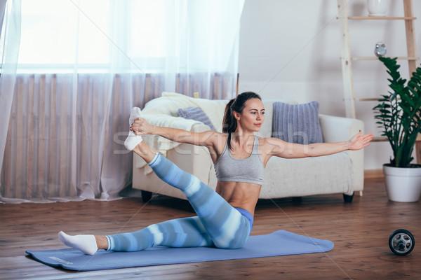 Fiatal derűs vonzó nő gyakorol jóga ül Stock fotó © chesterf