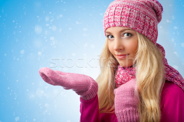 woman catching snowflakes Stock photo © chesterf