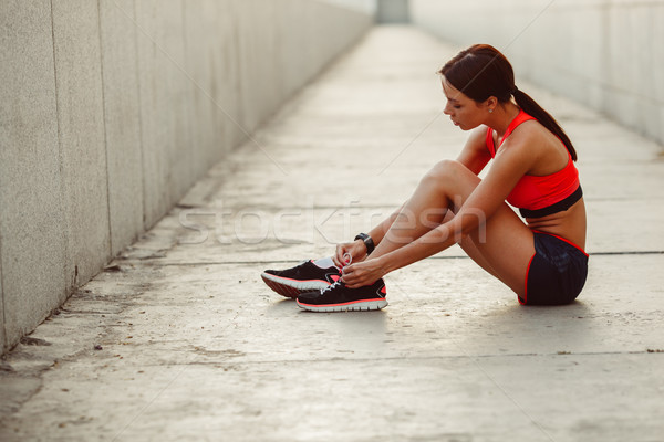 runner woman sitting on the ground and tie laces Stock photo © chesterf