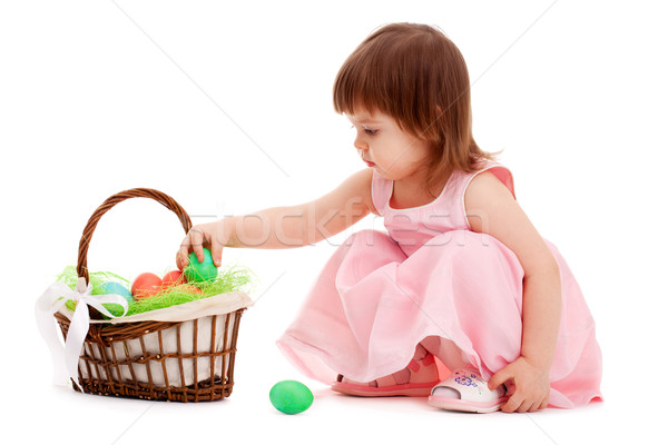 little girl playing with eater eggs Stock photo © chesterf