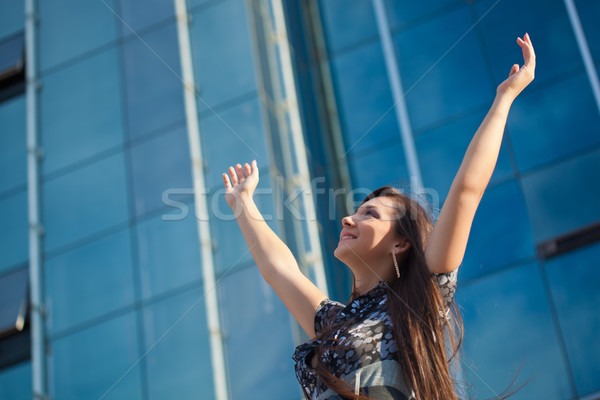 woman rising up hands Stock photo © chesterf