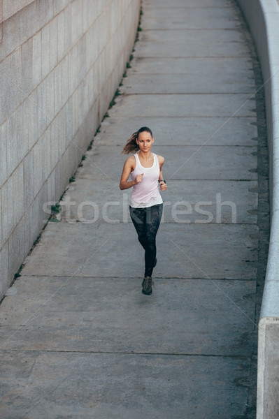 woman running in concrete urban scape Stock photo © chesterf