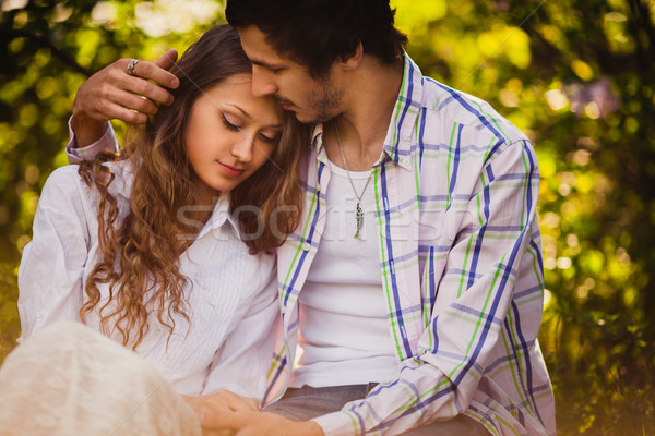 couple in love sitting at summer park Stock photo © chesterf