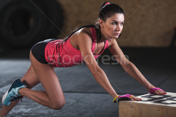 woman doing workout in  the gym Stock photo © chesterf