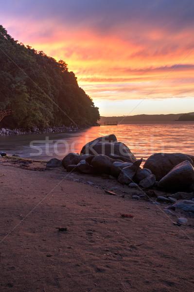 драматический закат морем дождливый вечер пляж Сток-фото © chesterf
