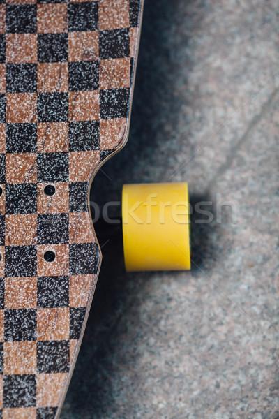 longboard standing on granite pavene Stock photo © chesterf