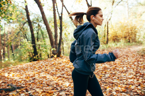 Runner woman jogging in autumn park. Motion blur effect Stock photo © chesterf