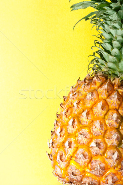 ananas with yellow background vertical Stock photo © chesterf