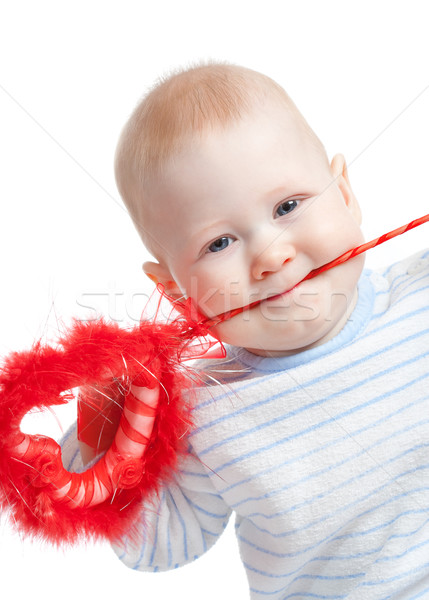baby boy with furry heart in mouth Stock photo © chesterf