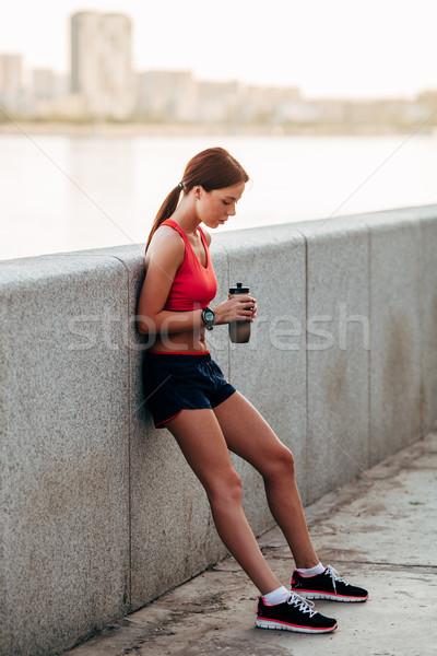 Female runner with bottled water Stock photo © chesterf