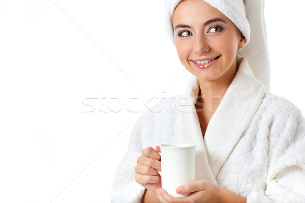 smiling woman in bathrobe holding mug Stock photo © chesterf