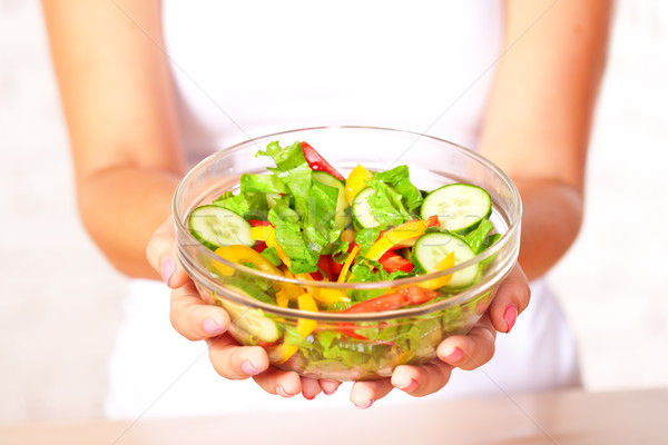 woman holding salad Stock photo © chesterf