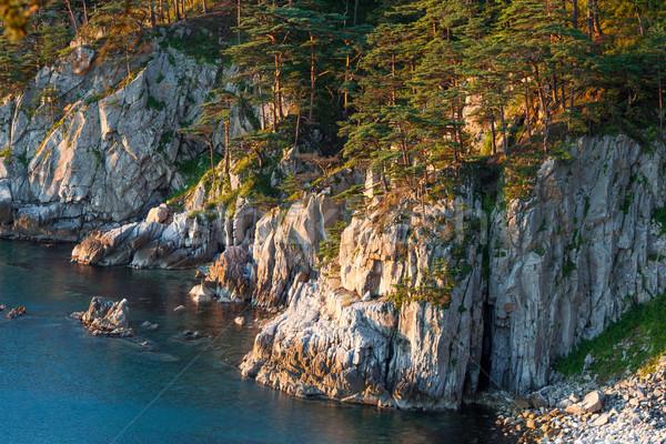 Rocas mar manana luz tumba Foto stock © chesterf