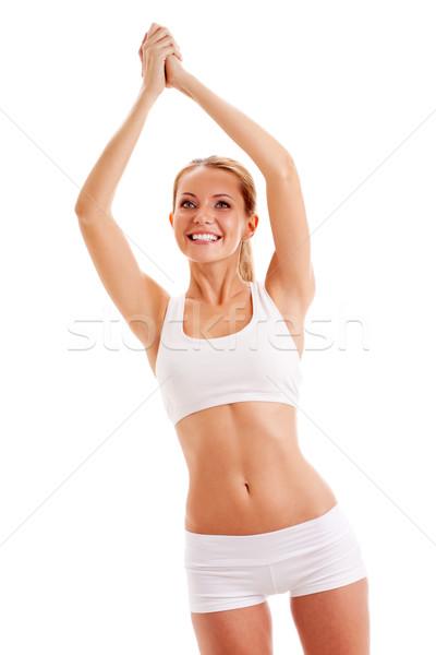Sportlich Frau weiß Aufgang up Hände Stock foto © chesterf