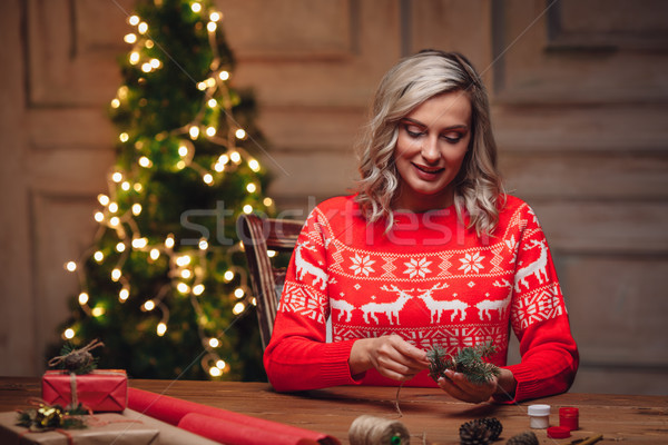 blonde woman wrapping gifts Stock photo © chesterf