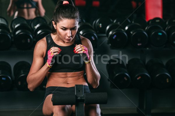 fitness woman doing abdominal crunch in gym woking out  Stock photo © chesterf