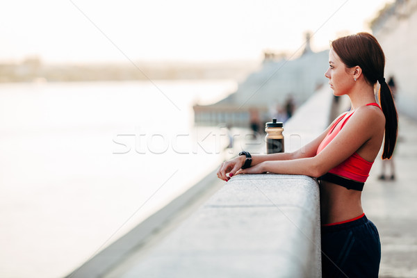 Female runner with bottled water Stock photo © chesterf