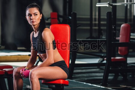 woman exercising dumbbell row at the gym Stock photo © chesterf