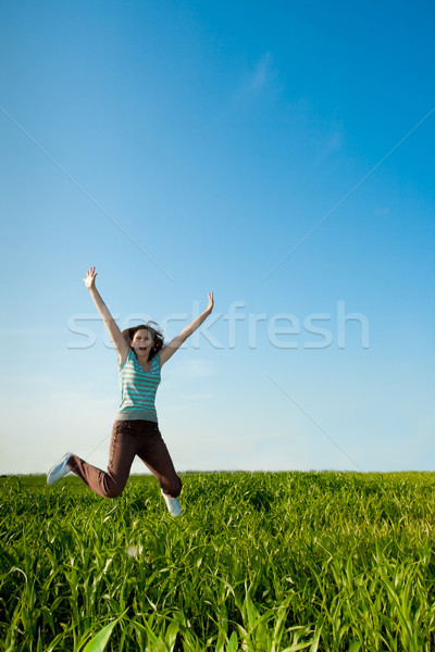 young woman jumping on geen field Stock photo © chesterf