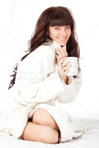 Femme blanche mug pansement robe Photo stock © chesterf