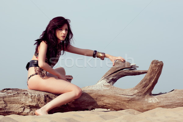 woman sitting on log Stock photo © chesterf