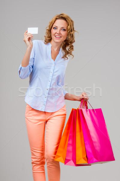 Nő tart üres kártya szatyrok boldog szőke nő Stock fotó © chesterf