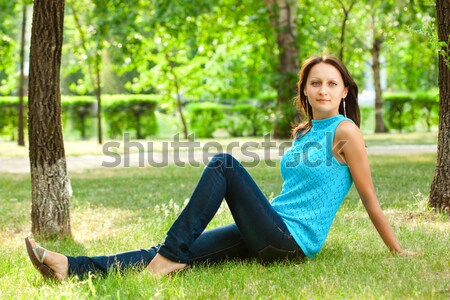 woman sitting under the tree Stock photo © chesterf