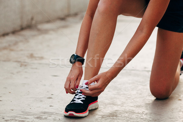 runner woman tying laces closeup Stock photo © chesterf